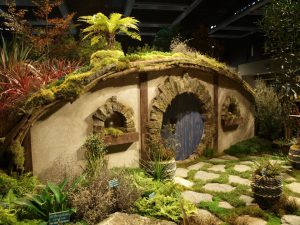 The hobbit house surrounded by stunning plants from New Zealand.