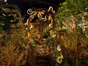 """A trellis gate hung with glass art in the """"Garden of Artful Delights."""""""