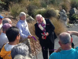 John cuts the ribbon to officially dedicate John Wott Way.